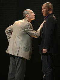Francis Jue as HYH and Hoon Lee as DHH in David Henry Hwang's YELLOW FACE at the Public Theater in New York. (Photo by Joan Marcus)