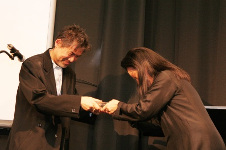 Tony Award-winning playwright David Henry Hwang was presented with a Lifetime Achievement Award from the Asian American Writers' Workshop at the Eleventh Annual Asian American Literary Awards Ceremony from M. Butterfly costume and stage designer Eiko Ishioka, to commemorate the 20th anniversary of his groundbreaking play M. Butterfly at New York University's Iris and B. Gerald Cantor Film Center in New York, on December 8, 2008. Photo by Lia Chang