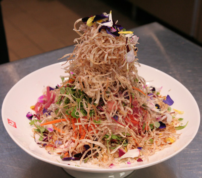 Chef Lee's signature Singapore Slaw served with yellowtail sashimi and tossed with a salted apricot dressing was the perfect starter to whet our appetites. (Photo by Lia Chang)