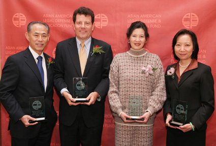 (l-r) San Francisco-based civil rights attorney and AALDEF co-founder Dale Minami; New York Times columnist Nicholas D. Kristof and Sheryl WuDunn, Pulitzer Prize-winning co-authors and human rights activists and Sandra Leung, Senior VP and General Counsel, Bristol-Myers Squibb received 2009 Justice in Action Awards from the Asian American Legal Defense and Education Fund at their 35th Anniversary gala dinner, at PIER SIXTY, Chelsea Piers in New York on March 26, 2009. (Photo by Lia Chang)
