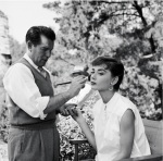 Audrey Hepburn and makeup artist Wally Westmore on the set of Paramount's Sabrina Fair in 1953.  Photo by Mark Shaw