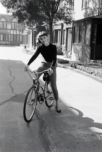 Audrey Hepburn regularly bicycled from the movie studio's make up department to the set. In the early days of her movie career, bicycles were a common mode of transportation to and from the set. Photo by Mark Shaw