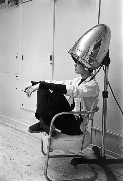 Photographed for LIFE in 1953, Audrey Hepburn, under the hair dryer, smokes a cigarette.  While working on the film Sabrina, Audrey was shampooed every night and often conducted business with her agents while under the dryer. Photo by Mark Shaw