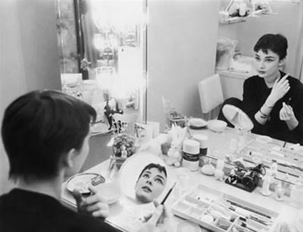 Audrey Hepburn photographed for Mademoiselle in 1954 in her dressing room backstage at Ondine. (Photo by Mark Shaw)