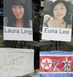 Signs at a vigil in New York for journalists Laura Ling and Euna Lee, who have been by sentenced by North Korea to 12 years hard labor in prison. Photo by Lia Chang