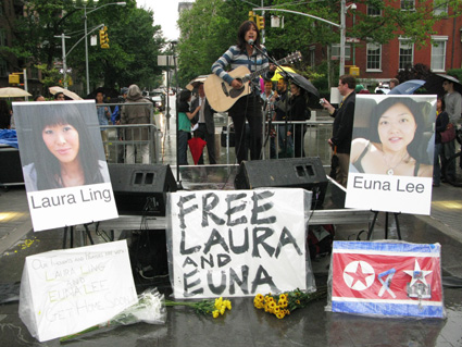 Singer/songwriter Waty lifts up her voice in song at the New York vigil for detained journalists Laura Ling and Euna Lee in Washington Square Park on June 3, 2009. Photo by Lia Chang