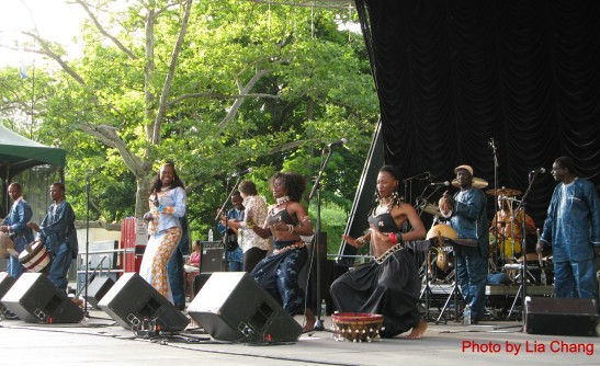Oumou Sangare and her band, featuring drummer Will Calhoun, perform at the Central Park Summerstage in New York on July 5, 2009. Photo by Lia Chang
