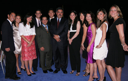 """Special Recognition Award recipient Steve Paulus, senior vice president/general manager of NY1 News is flanked by his NY1 family and sister """"Hair"""" director Diane Paulus (right) at the AAJA Scholarship and Awards banquet at the Seaport World Trade Center in Boston on August 15, 2009. (Photo by Lia Chang)"""