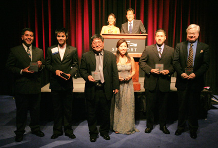 2009 AAJA National Journalism Award winners (L-R) Brian Bull, Wisconsin Public Radio; Vino Wong, photojournalist, Altanta Journal-Constitution; Craig Gima, assistant city editor/reporter, Honolulu Star-Bulletin; Jinah Kim, correspondent, NBC News; Bryan Chu, sports reporter, San Francisco Chronicle; Barry Petersen, CBS News correspondent with banquet co-emcees Arthur Chi'en reporter/host with WPIX-TV/New York, and Frances Rivera, anchor, 7News and CW56 in Boston. © Lia Chang