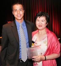 Foster Hays, son of Dr. Suzanne Ahn, congratulates Lifetime Achievement Award recipient Dinah Eng. © Lia Chang