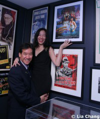 Lia Chang with her fellow Big Trouble in Little China castmate Peter Kwong in front of the French poster of Big Trouble in Little China.© Tami Chang