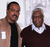 Nathan Purdee and New Federal Theatre's Woodie King, Jr. at <strong>THE RIVER CROSSES RIVERS</strong> opening night party on October 8, 2009 in the lobby of the Castillo Theatre in New York. © Lia Chang