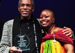 Six time Audelco award winner André De Shields (Outstanding Performance in Musical, Male) with presenter Natalie Clark at the 37th Annual Audelco Awards at Aaron Davis Hall in New York on Monday, November 16. © Tanja Hayes