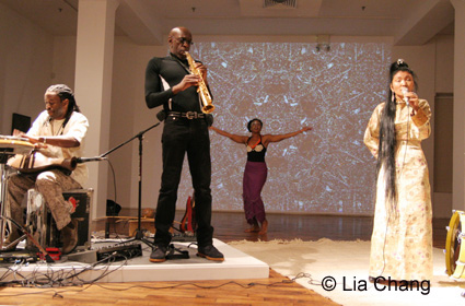 Will Calhoun performs with saxophonist Jeff Smith, dancer Ethel Calhoun and Tibetan vocalist Yung Chen Lhamo on October 28, 2009 at the Chelsea Art Museum in New York. © Lia Chang