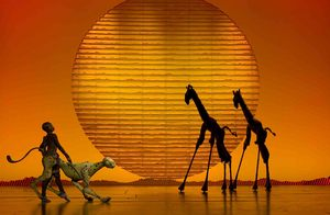 Marija Juliette Abney, Jeremiah Tatum, and Derrick Spear in the opening number The Circle of Life from THE LION KING Las Vegas. (c)2009, Disney. Photo Credit: Joan Marcus.