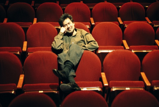 David Henry Hwang sits in the Virginia Theatre in New York before the curtain for Flower Drum Song in March, 2003. Photo by Lia Chang
