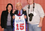 Wat Misaka, the first draft pick of the New York Knicks in 1947, was honored by the New York Knicks at Madison Square Garden on December 20, 2009. He is flanked by filmmakers Christine Toy Johnson and Bruce Alan Johnson. Photo by Lia Chang