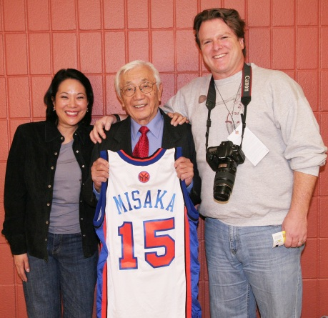 Wat Misaka, the first draft pick of the New York Knicks in 1947, was honored by the New York Knicks at Madison Square Garden on December 20, 2009. He is flanked by filmmakers Christine Toy Johnson and Bruce Alan Johnson, who produced the award-winning documentary, Transcending: The Wat Misaka Story. Photo by Lia Chang