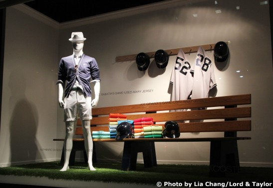Helmets, jerseys and an authentic bench from Yankee Stadium are on display in the Lord & Taylor Fifth Avenue Flagship store windows. Photo by Lia Chang/Lord & Taylor