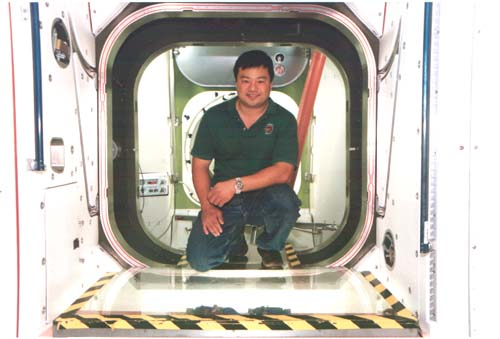NASA astronaut Dr Leroy Chiao in the mock-up on the International Space Station in Houston, TX in December, 2000.  Dr. Chiao was the first Chinese American astronaut to do a spacewalk and the first Asian American commander of the International Space Station. Photo by Lia Chang