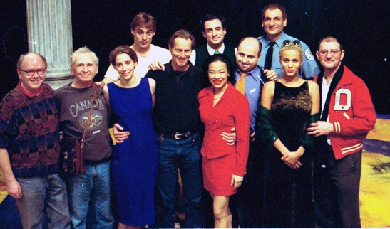 Lia Chang (center) with Sam Shepard and the cast of the Signature Theatre's production of Chicago on the set at The Public Theatre in New York in 1996.