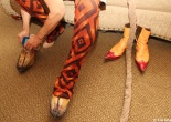 Thom Sesma puts on his Scar boots, next to Zazu's boots. Photo by Lia Chang