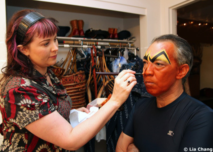 Makeup artist Laura Sill transforms Thom Sesma into Scar, in his dressing room of the Mandalay Bay Theatre, where The Lion King Las Vegas currently has an open run. Photo by Lia Chang