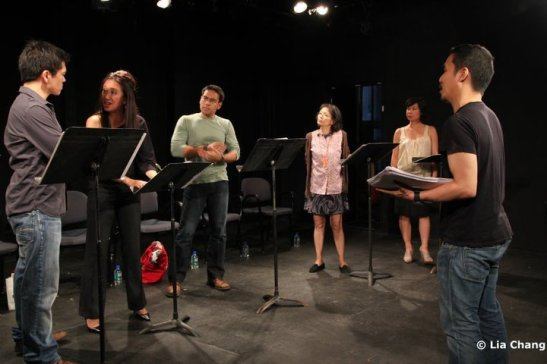 HANDBAG Director Victor Lirio (far right) in rehearsal with cast.  Photo by Lia Chang, Copyright 2010.