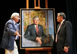 Reminiscing his past at a podium next to his own portrait, former Secretary of Transportation Norman Mineta spoke to an audience of over 100 people who were there to witness the entrance of the artwork into the National Portrait Gallery's permanent collection. Photo courtesy of the Smithsonian Asian Pacific American Program