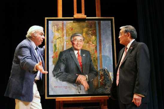 Reminiscing his past at a podium next to his own portrait, former Secretary of Transportation Norman Mineta spoke to an audience of over 100 people who were there to witness the entrance of the artwork into the National Portrait Gallery's permanent collection in Washington D.C. on July 26. Photo courtesy of the Smithsonian Asian Pacific American Program