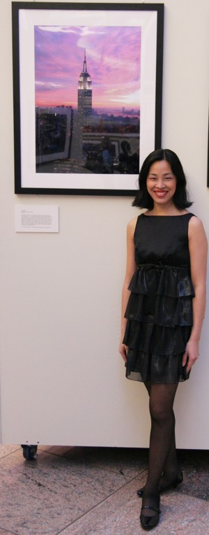"Artist Lia Chang with her ""Empire State Building at Dusk"" (2007) photograph."