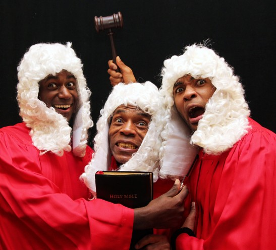 (L-R) Sean Phillips, André De Shields and Alexander Elisa in The Sovereign State of Boogedy Boogedy. Imagine an episode of Law & Dis-Order: SV eeeeew! Double lippin' and entenDRÉ flippin' with Flavor Flav, Judge Judy, Angela Davis and the Mad Hatter. Photo by Lia Chang