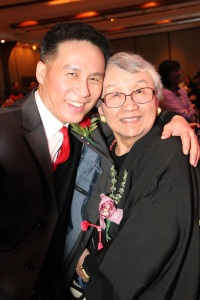 2011 AALDEF Justice in Action Awardee Lillian Kimura gets a hug from Law and Order SVU actor BD Wong. Photo by Lia Chang