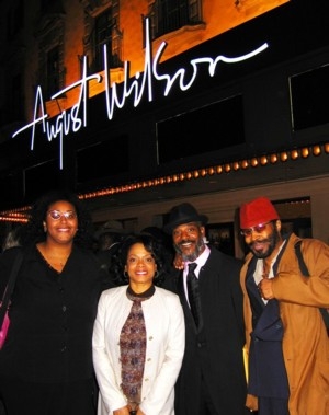On October 16, 2005, fourteen days after American playwright August Wilson's death, the theatre was renamed in his honor. (l-r) August Wilson's niece Kimberly Ellis with Radio Golf castmembers Denise Burse, John Earl Jelks and Anthony Chisholm in front of the August Wilson Theatre on October 16, 2005.  Photos by Lia Chang