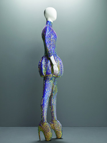 "Alexander McQueen (British, 1969–2010), ""Jellyfish"" Ensemble, Plato's Atlantis, spring/summer 2010, Dress, leggings, and ""Armadillo"" boots embroidered with iridescent enamel paillettes, Courtesy of The Metropolitan Museum of Art, Photograph © Sølve Sundsbø/Art + Commerce"