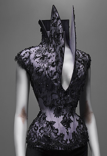Alexander McQueen (British, 1969–2010), Corset, Dante, autumn/winter 1996–97, Lilac silk faille appliquéd with black silk lace and embroidered with jet beads, Courtesy of The Metropolitan Museum of Art, Photograph © Sølve Sundsbø/Art + Commerce