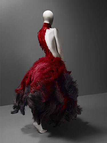 Alexander McQueen (British, 1969–2010), Dress, VOSS, spring/summer 2001, Red and black ostrich feathers and glass medical slides painted red, Courtesy of The Metropolitan Museum of Art, Photograph © Sølve Sundsbø /Art + Commerce