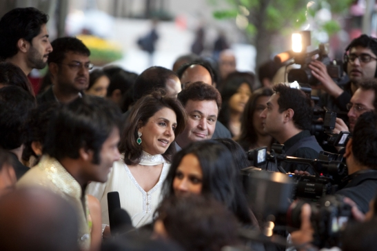 (L-R) Neetu Singh Kapoor and Rishi Kapoor on the red carpet.  Photo credit: MichaelToolan.com