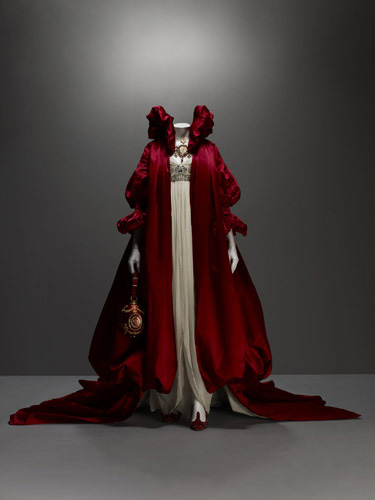 Alexander McQueen (British, 1969–2010), Ensemble, The Girl Who Lived in the Tree, autumn/winter 2008–9, Coat of red silk satin; dress of ivory silk chiffon embroidered with crystal beads, Courtesy of The Metropolitan Museum of Art, Photograph © Sølve Sundsbø/Art + Commerce