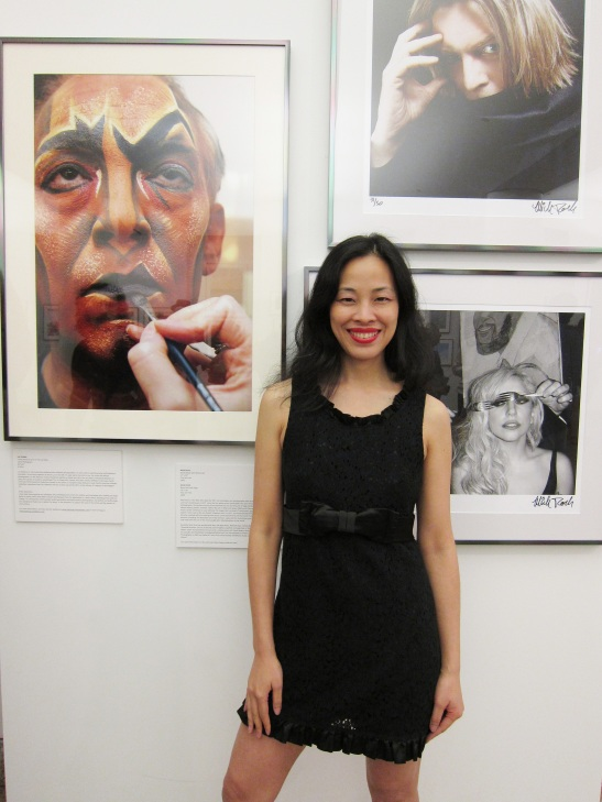 Lia Chang poses in front of her portrait of Thom Sesma's Makeup Transformation as Scar in Disney's The Lion King, at HHC's New York City: IN FOCUS, Vol. 2 Photo Exhibit opening reception at Bellevue Hospital on June 23, 2011. Photo by Brianne Michelle Photography