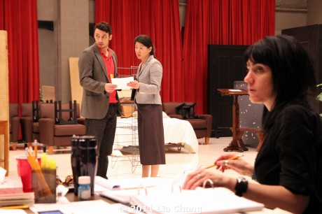 (L-R) James Waterston (Daniel) and Jennifer Lim (Xu Yan) getting a note from Chinglish translator Candace Chong, as director Leigh Silverman looks on in the Healy Room of the Goodman Theatre in Chicago on June 5, 2011 . © 2011 Lia Chang