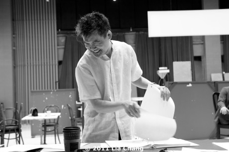 Playwright David Henry Hwang adds new pages to his script during a rehearsal for Chinglish in the Healy Room of the Goodman Theatre in Chicago on June 5, 2011. © 2011 Lia Chang