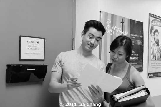 Chinglish Castmembers Johnny Wu and Angela Lin review their bios during a break from rehearsal outside the Healy Rehearsal Room of the Goodman Theatre in Chicago on June 5, 2011. © 2011 Lia Chang