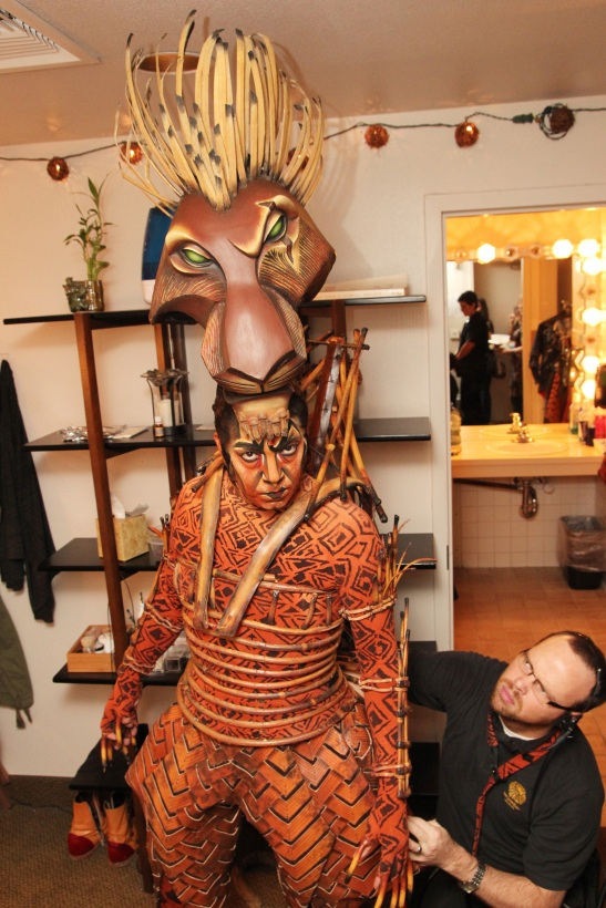 Photo #281 Thom Sesma with his dresser Craig West in his dressing room at the Mandalay Bay Theatre, where he is currently starring as Scar in Disney's The Lion King Las Vegas. Credit:  Photo from The Lia Chang Theater Portfolio at the Library of Congress/AAPI Collection