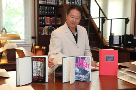 Rick Shiomi checks out the Performing Arts Playwrights Series in the Asian American Pacific Islander Collection Photo by Lia Chang