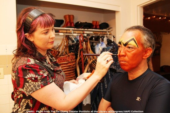 Makeup artist Laura Sill transforms Thom Sesma into Scar, in his dressing room at the Mandalay Bay Theatre, where The Lion King Las Vegas has performances through December, 2011.  Credit:  Photo from The Lia Chang Theater Portfolio at the Library of Congress/AAPI Collection