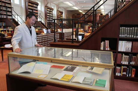 Rick Shiomi looks at a glass case of the published works of his fellow Asian American Theater Pioneering peers including Frank Chin, Philip Kan Gotanda, David Henry Hwang, Velina Hasu Houston and Genny Lim.  Photo by Lia Chang