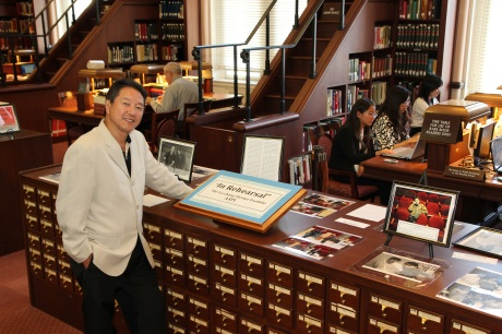 """Rick Shiomi with my display of photos """"In Rehearsal"""", drawn from the Lia Chang Theater Portfolio at the Library of Congress/AAPI Collection. Photo by Lia Chang"""