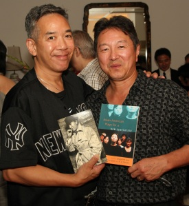 Henry Chang, noted mystery/crime fiction novelist, surprised Rick with an original script of Yellow Fever for him to sign. Photo by Lia Chang