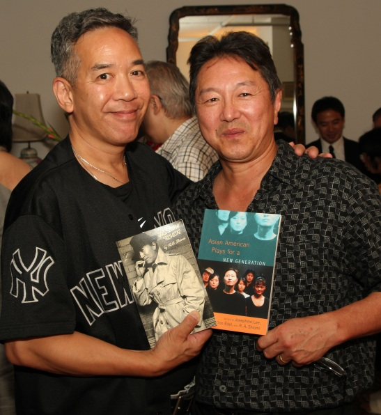 Henry Chang, noted mystery/crime fiction novelist  with Rick Shiomi, playwright, Artistic Director of Mu Performing Arts and co-editor of Asian American Plays for A New Generation, at a book party in New York on July 29, 2011. Photo by Lia Chang